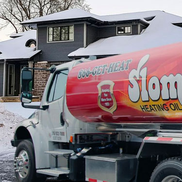 Slomin's oil truck outside house