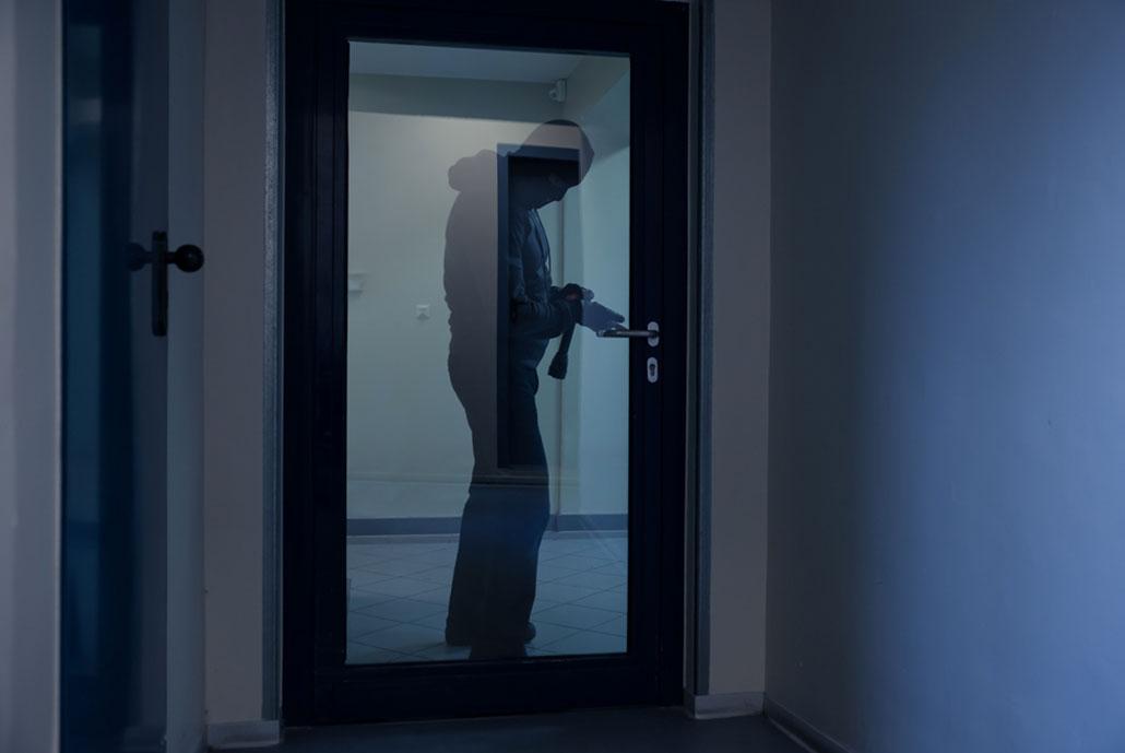burglar trying to break into a business
