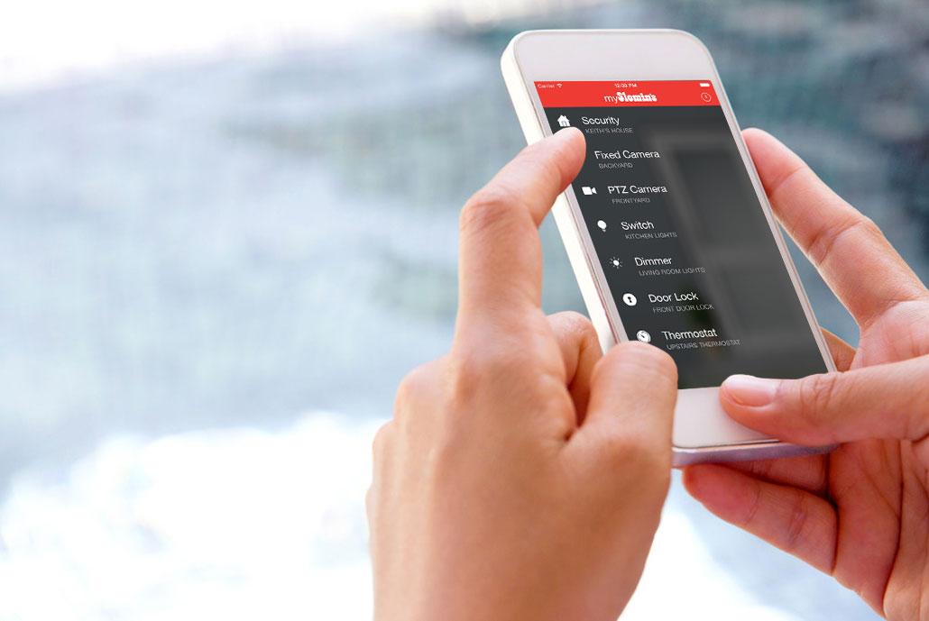 person viewing surveillance footage via mobile app