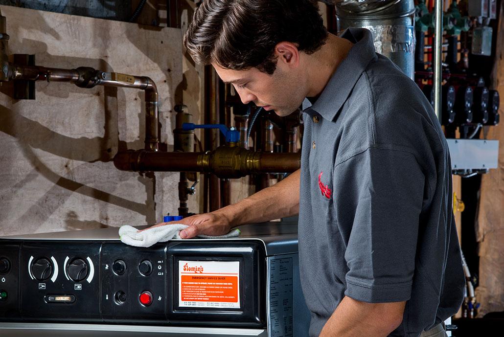 technician inspecting heating unit