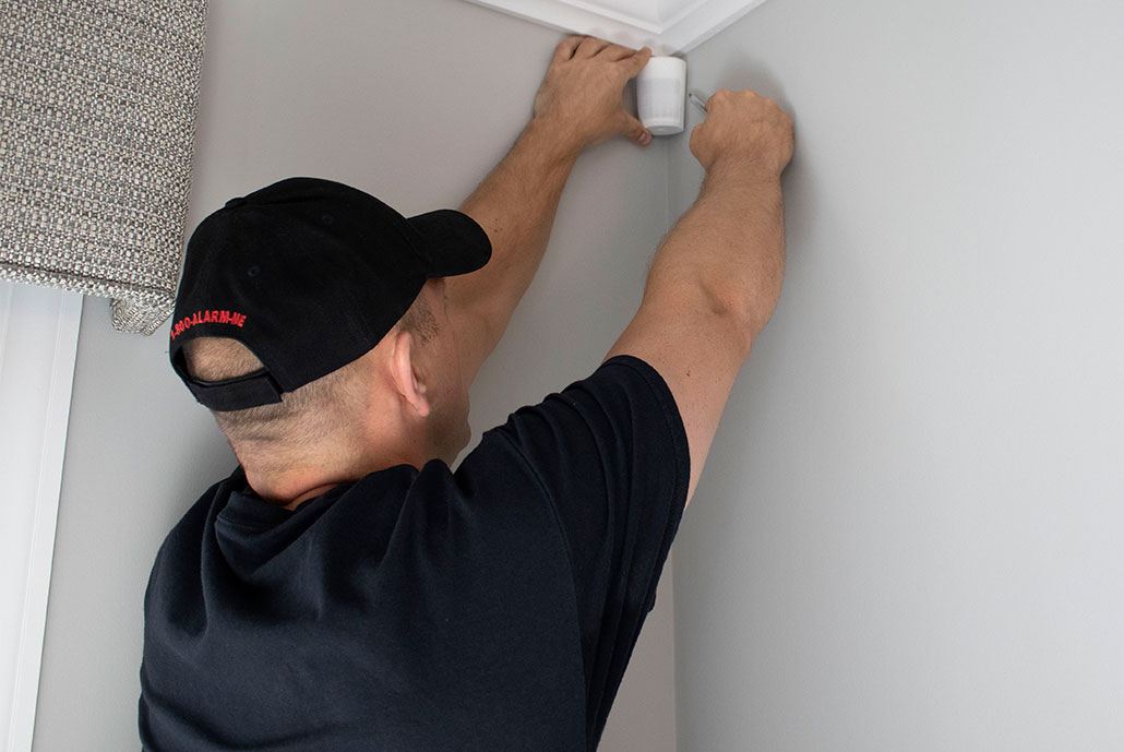 slomins technician installing home automation device