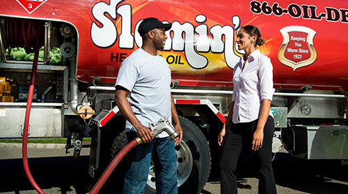 slomins oil technician consulting a business owner