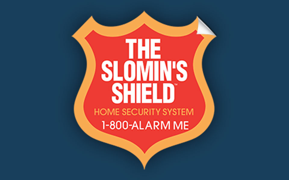 slomins lawn and window sign