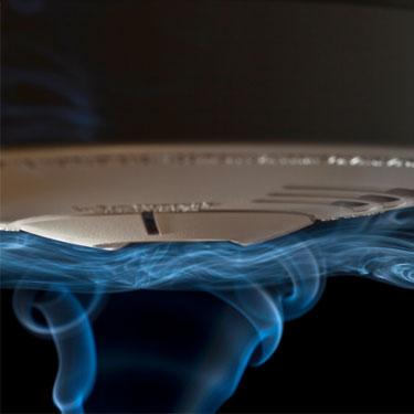 smoke rising up to smoke alarm on ceiling