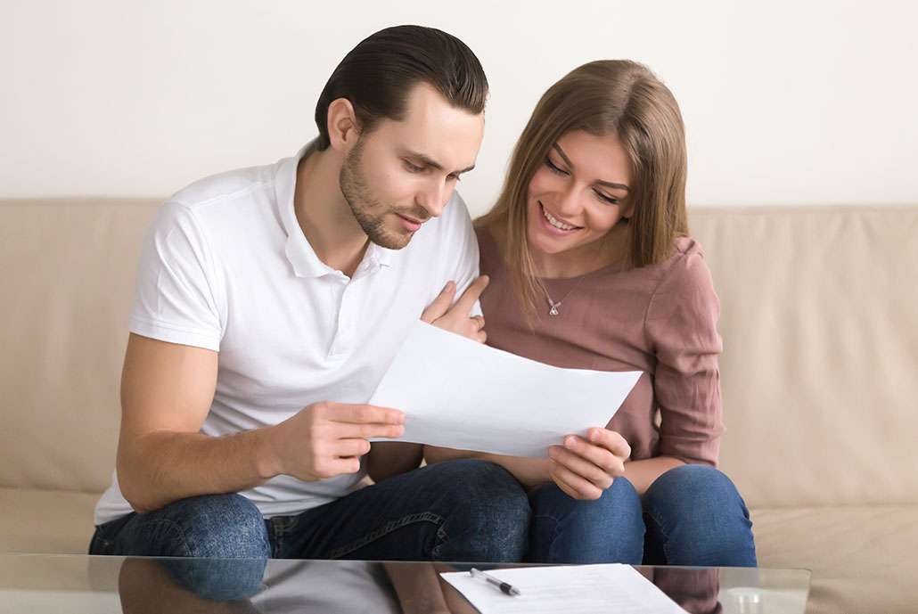 Couple receiving referral credit on their bill