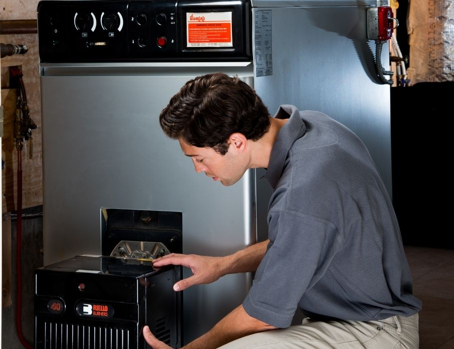slomins technician working on heating system