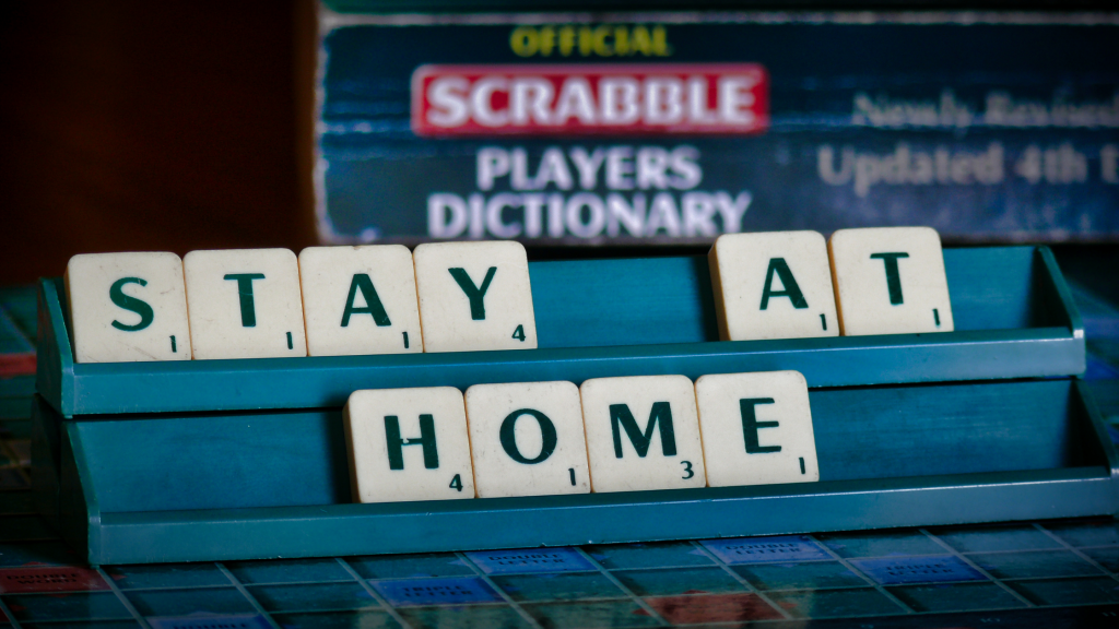 stay at home written out on a game board