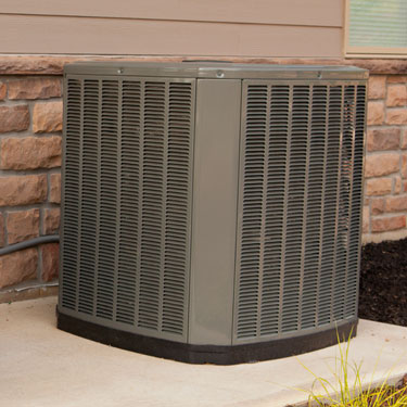 two air conditioner condenser units on concrete slab