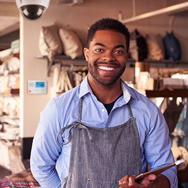 black business owner in shop with slomin's security camera