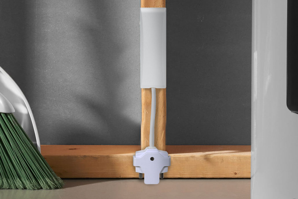 slomins water sensor in laundry room near broom