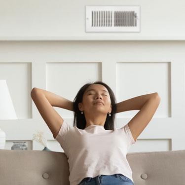 Woman enjoying clean air through Slomin's HVAC